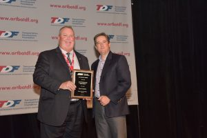 HNTB Corp's Tim Faerber accepts the Guy Kelcey Award from P&D Division Director Doug LaVoie